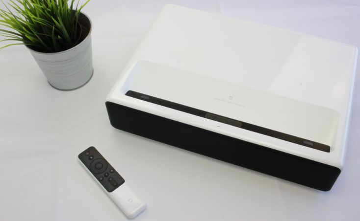 Xiaomi short throw projector with its remote controller