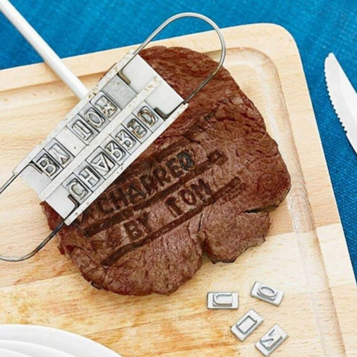 Branding iron with inscribed steak