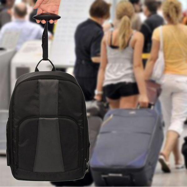 Suitcase scale on a backpack