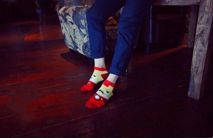 superhero socks on the feet