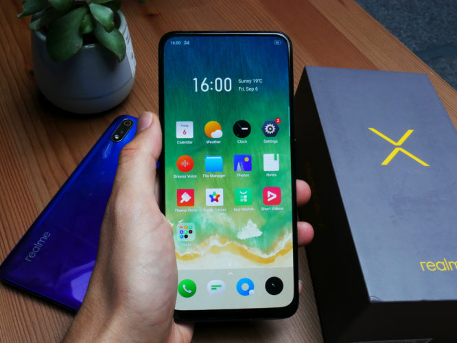 Realme X Smartphone Display in Hand
