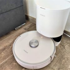 Neabot NoMo vacuum robot at suction station