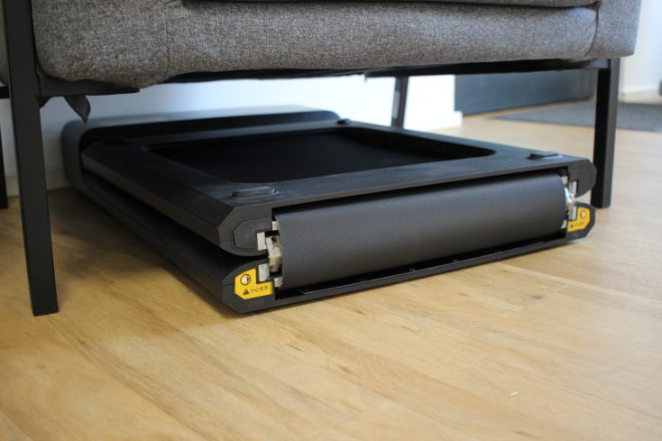 WalkingPad A1 Pro stored beneath chair