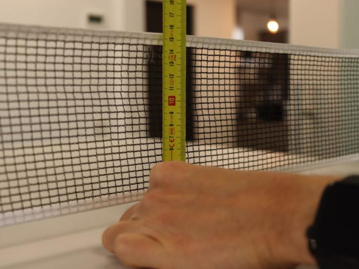 Extendable table tennis net height
