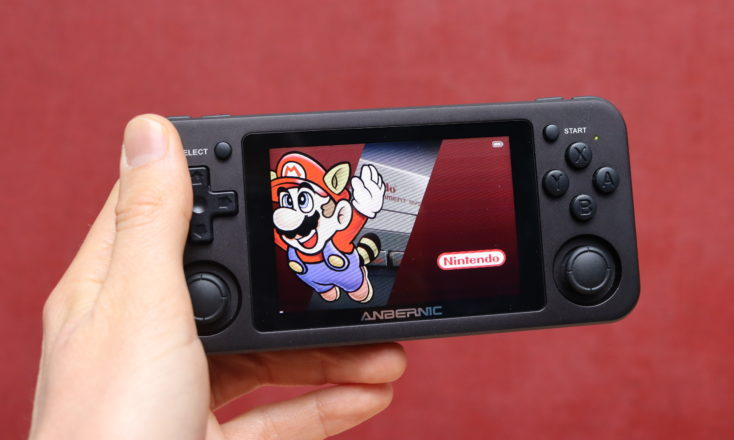 Anbernic RG351 game console in hand Mario